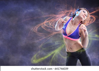 young woman in sport dress dancing in aerobics or reggaeton or hiphop style