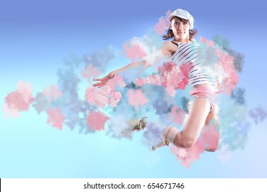 young woman in sport dress dancing in zumba or reggaeton or hiphop style