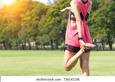 Young woman Sport girl stretching warming up before exercise training, cool down after work out. resting relaxation in park outdoor. stretching leg back view. slim body, weight loss healthy concept.