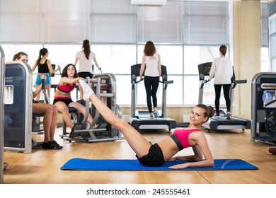 Young woman in sport wear doing sport in gym