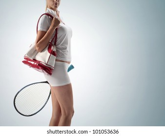 young woman with a sports bag and racket tennis