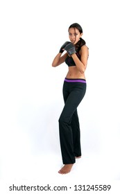 Young woman in sportswear boxing on white background