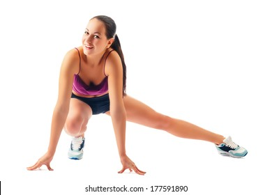 young woman in sportswear does exercises on white background