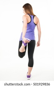 Young woman in sportswear stretch before (after) exercise (jogging). On a white background. Healthy lifestyle