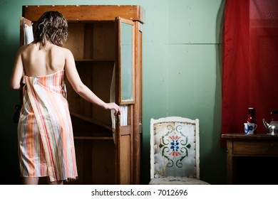 young woman stand front empty wardrobe