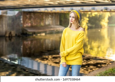 young woman standing by the canal
