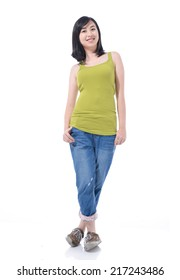 Young woman in standing casual and isolated in full length. Smiling and looking gorgeous.