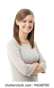 Young woman standing with folded hand against white background