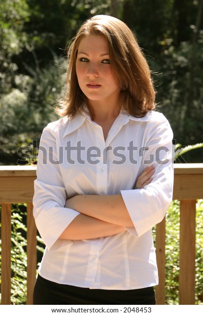 Young Woman Standing With Her Arms Crossed