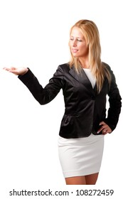 Young woman standing with her hand outstretched, as though she is presenting a product