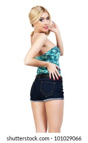 Young woman standing with his back to the denim shorts.