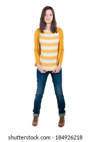 A young woman standing in jeans and a T-shirt. Isolated over white