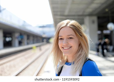 young woman is standing on platform