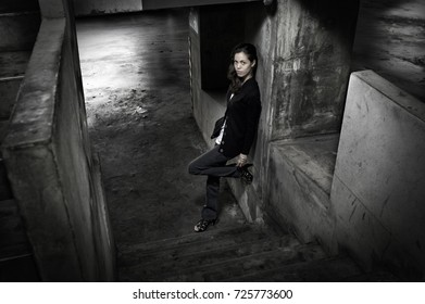 Young woman standing in a parking garage.