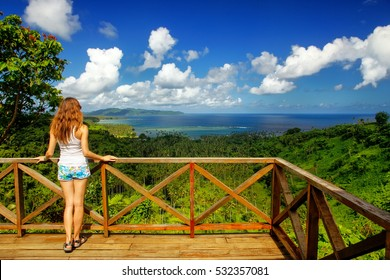 Young woman standing at the viewpoint in Bouma National Heritage Park on Taveuni Island, Fiji. Taveuni is the third largest island in Fiji.