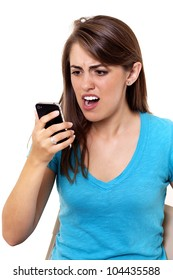 young woman stares angrily at her smart phone