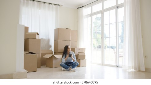 Young woman starting a new life in a new home