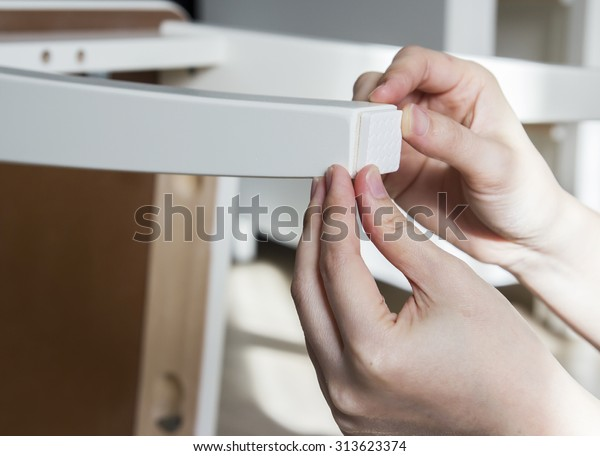 Young woman are sticking floor care pad at chair legs