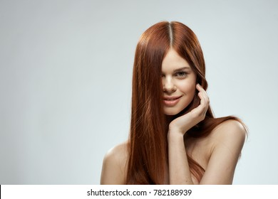 young woman with straight hair on a light background portrait, hairstyle