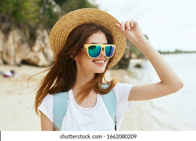 young woman in a straw hat in the fresh air