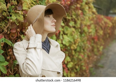 Young woman in the street in autumn scenery