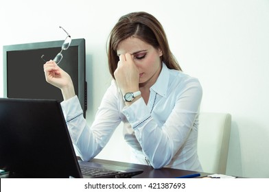 Young woman stressed at work.
