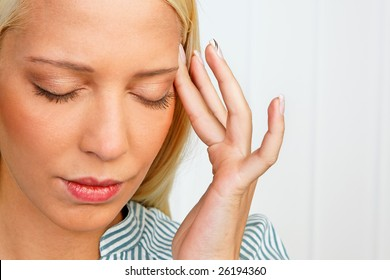 Young woman with stress-related pain in the head