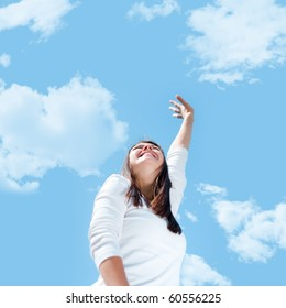 A young woman stretches her hand towards the sky.
