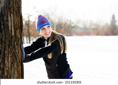 Young woman stretching before winter run