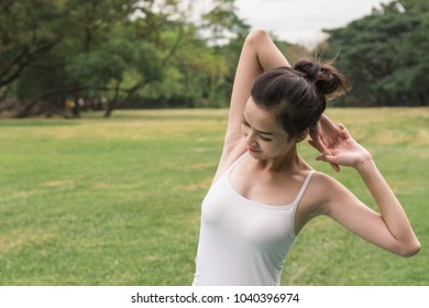 Young woman stretching her arm and shoulder.