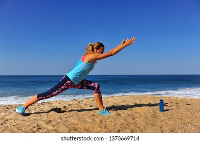 Young woman and stretching in the morning on beach