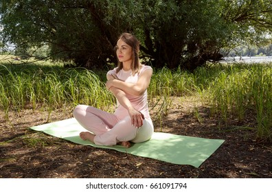 young woman stretching in nature - fitness, sport, training and lifestyle concept
