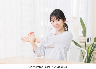 A young woman stretching in a room shot in the studio