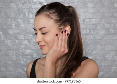 young woman struggles with earache