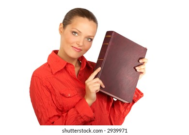 Young woman student holding a book. Isolated over white