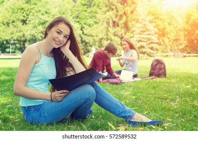 Young woman student reading textbooks. Student life everyday.