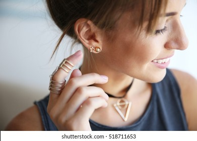 Young woman with stylish accessories, closeup