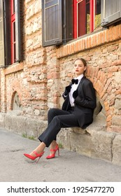 Young woman in a stylish business suit shirt, tie, jacket. Businesswoman, business style, fashio