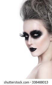 Young woman with stylish fancy gothic Halloween make-up and hairdo over white background, copy space