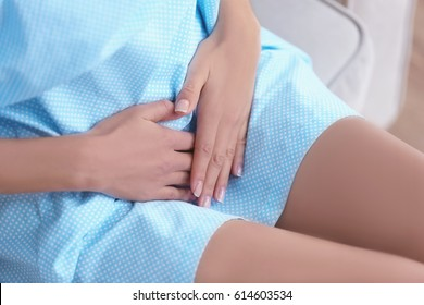 Young woman suffering from abdominal pain, closeup. Gynecology concept