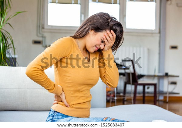 Young Woman Suffering Backache Home Portrait Stock Photo Edit Now 1525083407