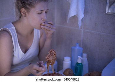 Young woman is suffering from bulimia nervosa