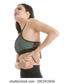 Young woman suffering from flank pain on white background