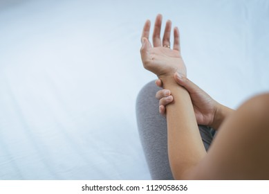 Young woman suffering with parkinson's disease symptoms,Selective focus hands