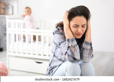 Young woman suffering from postnatal depression at home