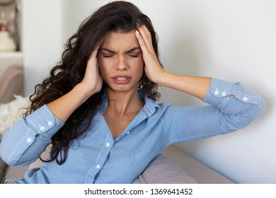 Young woman suffering strong headache