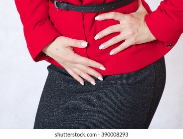 A young woman suffers from a pain in the down part of her belly