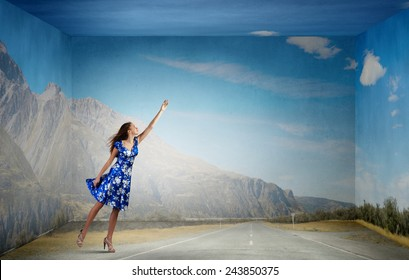 Young woman in summer dress flying in sky