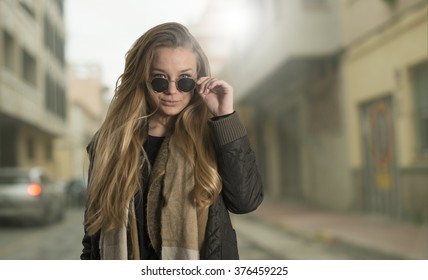 Young woman with sun glasses in the street