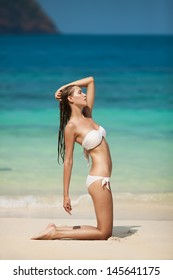 Young Woman Sunbathing At Tropical Beach